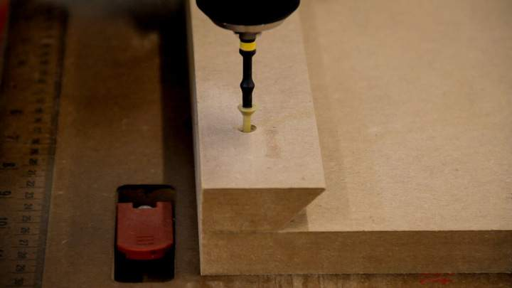 A screw is used to attach an MDF cleat to the back.