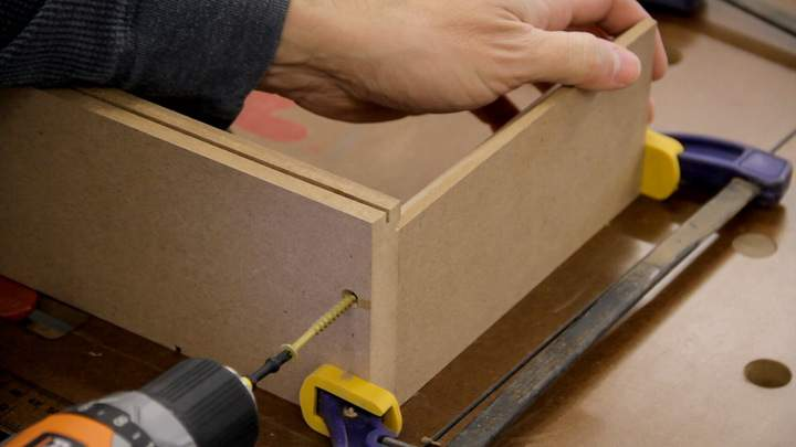 A screw is used to attach the MDF inner side to the bottom.