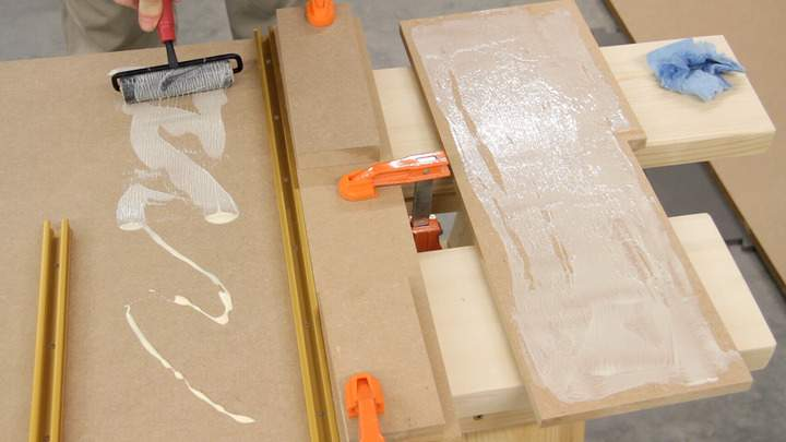 Glue is applied to pieces of MDF.