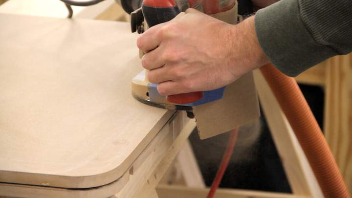 A router is used to route a slot in the edge of the table.