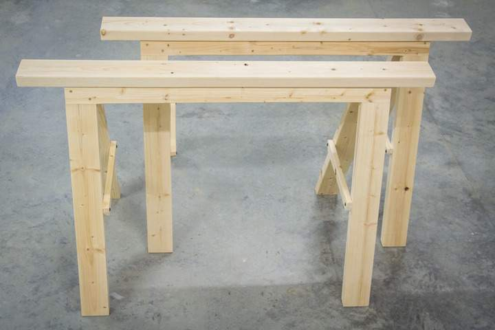 A pair of wooden folding sawhorses.