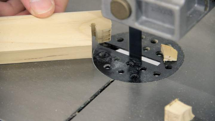A band saw is used to cut a notch.