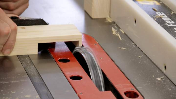 A table saw dado blade is used to cut the second half of a lap joint.