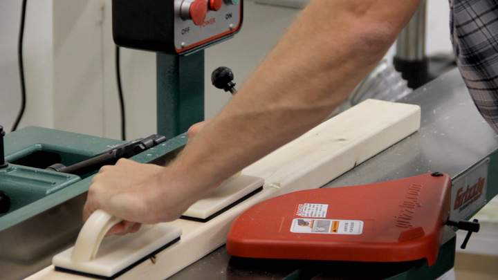 A power jointer is used to join a 2x4.