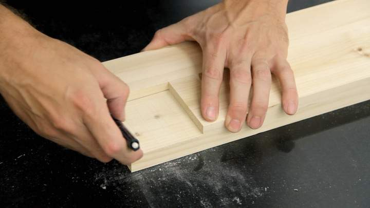 A pencil is used to mark the second half of a lap joint.