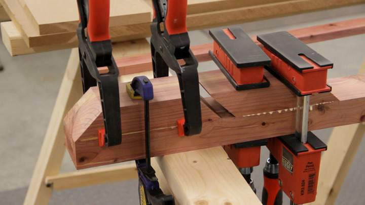 Clamps are used to glue the front pieces of cedar to the back piece.