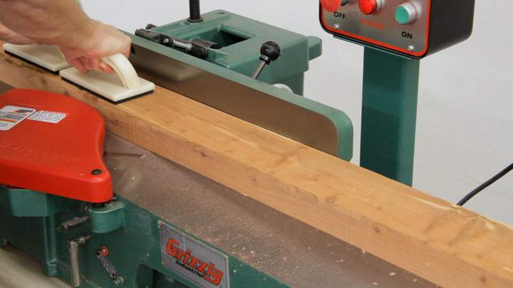 A jointer is used to join a cedar board.