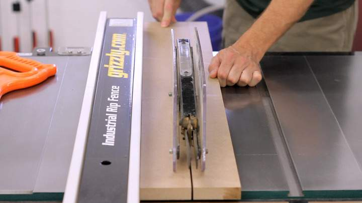 A long piece of MDF is cut at the table saw.