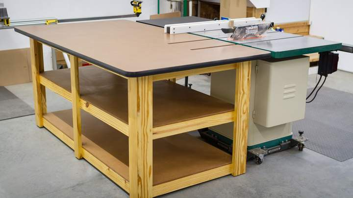 A large workbench adjacent to a table saw.