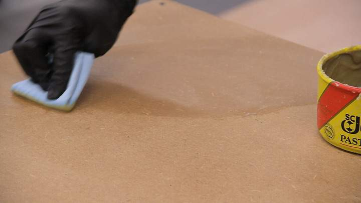Paste wax is applied to an MDF shelf top.