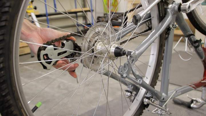Removing a rear bicycle wheel.