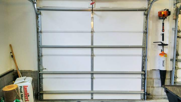 A single bay garage door with insulation.
