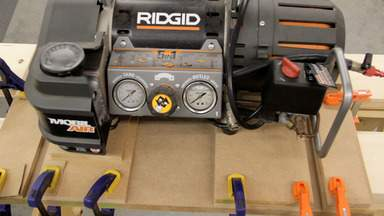 A band saw is used to cut a long notch in a piece of MDF.