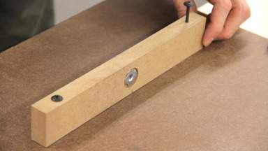 A thicker piece of MDF with a T-nut is screwed into the table bottom.