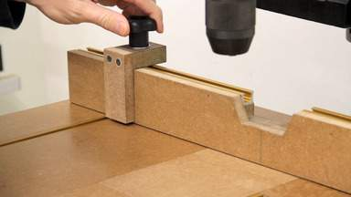 A drill press table and stop block.