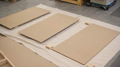 Small blocks are used to raise MDF panels off the floor.
