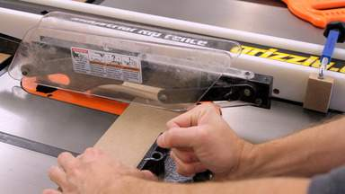 A table saw is used to cut the rack pieces.