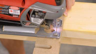 A jigsaw is used to cut slots in the top of the rack.
