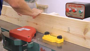 A jointer is used to flatten the edge of a piece of lumber.