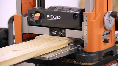 A planer is used to surface a piece of lumber.