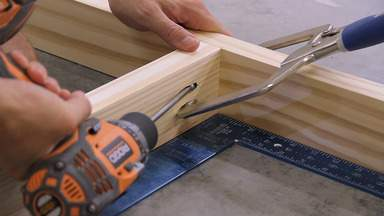 A pocket hole clamp and drill are used to screw together the frame.