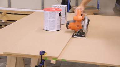 A circular saw is used to cut a piece of MDF.